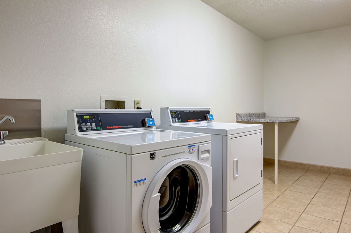 Laundry room with front loading washer and dryer.