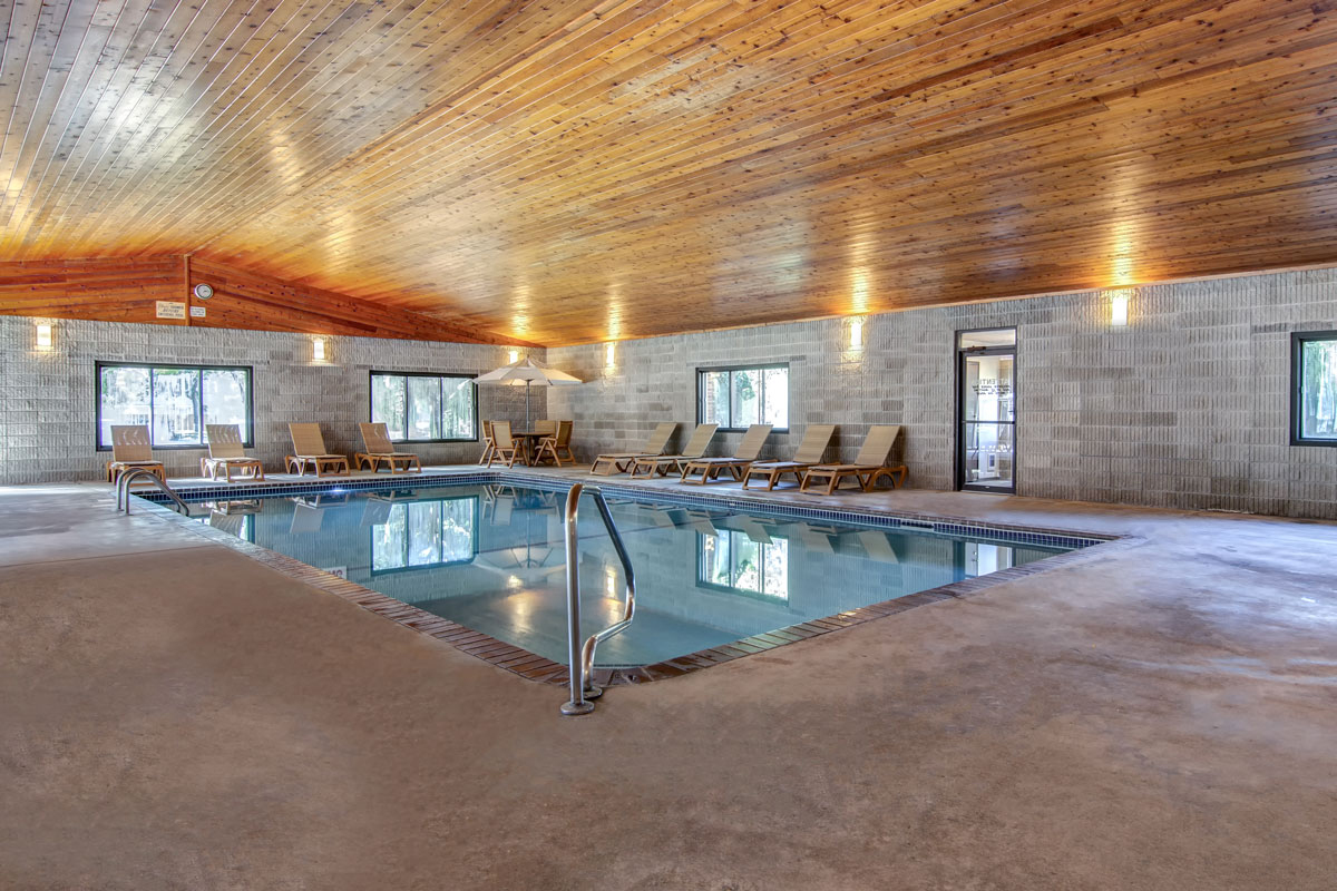 Large indoor pool with seating surrounding