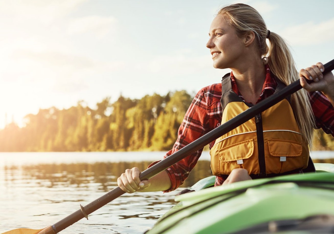 Woman with blonde hair kayaking